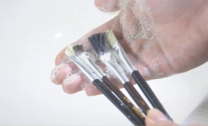 Cleaning paintbrushes with soap and water