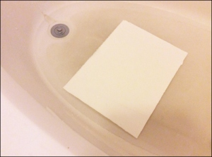 Soak the paper well in a shallow bath